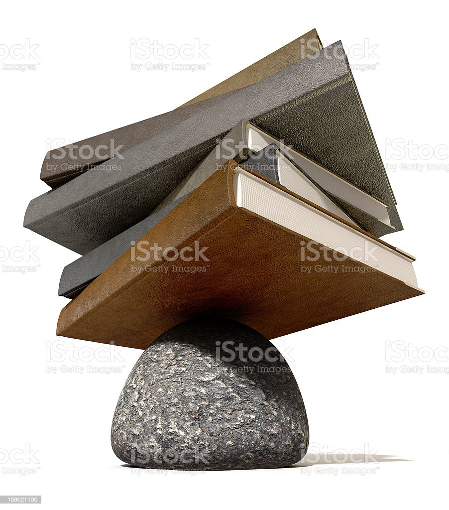 Balancing The Books On A Rock royalty-free stock photo