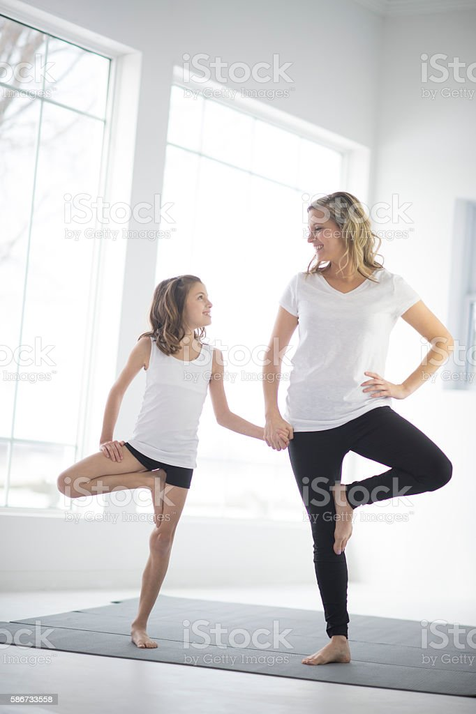 Balancing Together in Tree Pose stock photo