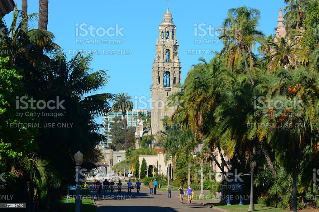 Balboa Park scene with palm trees, California Tower, and visitors stock photo