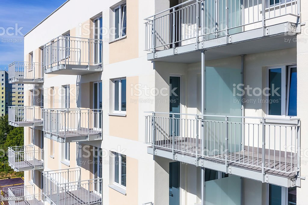 Balconies in white modern apartment building stock photo