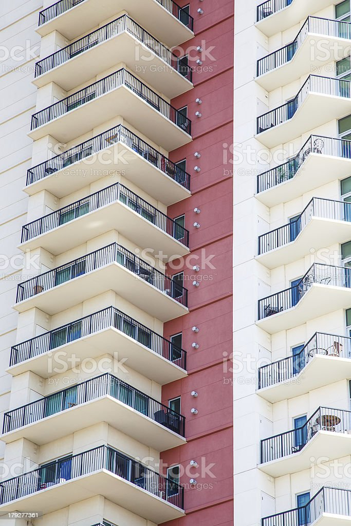 Balconies with Wrought Iron Railings by Red Wall royalty-free stock photo