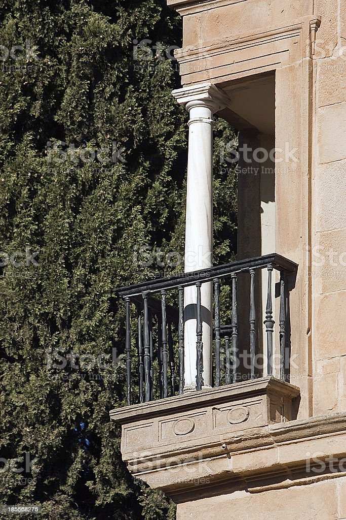 Balcony at corner with white column, Ubeda, Spain stock photo