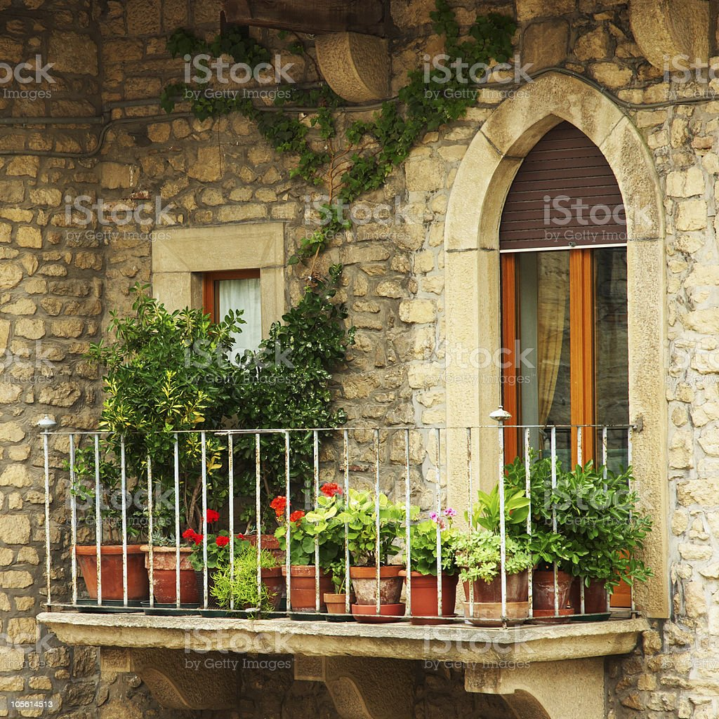 Balcony filled with green plants royalty-free stock photo