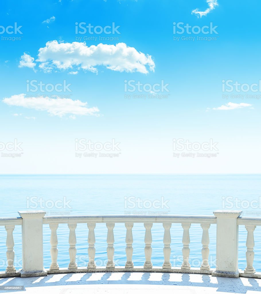 balcony near sea and blue sky with clouds stock photo