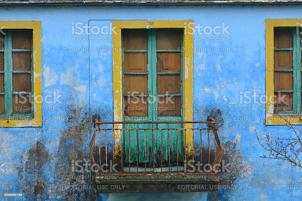 Balcony of a colorful abandoned house stock photo