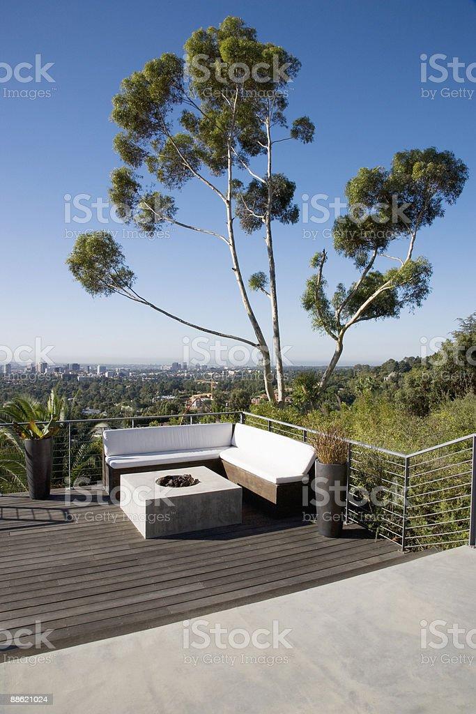 Balcony seating area overlooking cityscape royalty-free stock photo