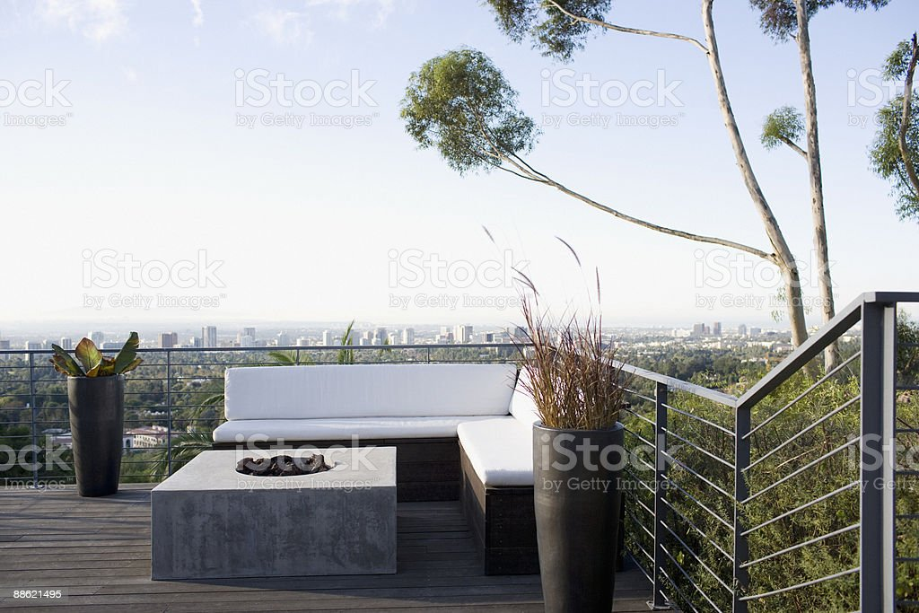Balcony seating area overlooking cityscape royalty-free stock photo