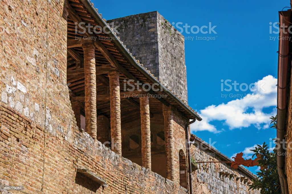 Balcony view on old brick building and tower in San Gimignano. stock photo