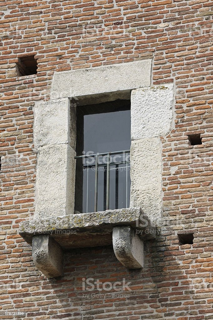 balcony window of an ancient medieval tower stock photo