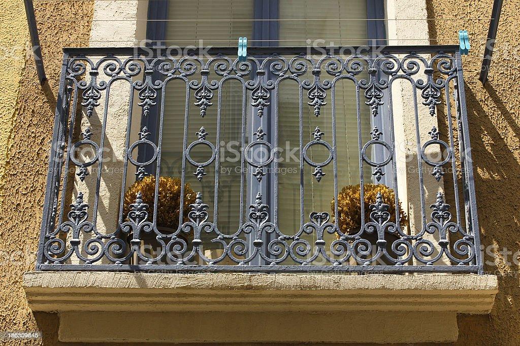 Balcony with blue wrought iron railing royalty-free stock photo