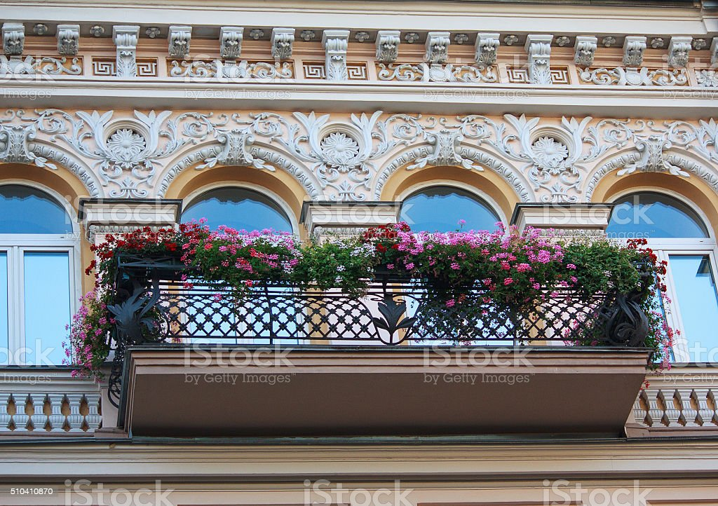 Balcony with flowers and facade stock photo