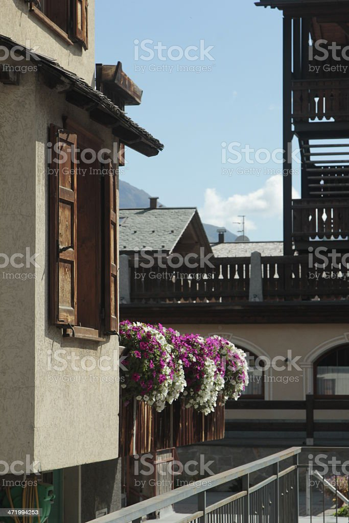 Balcony with flowes and wooden window stock photo