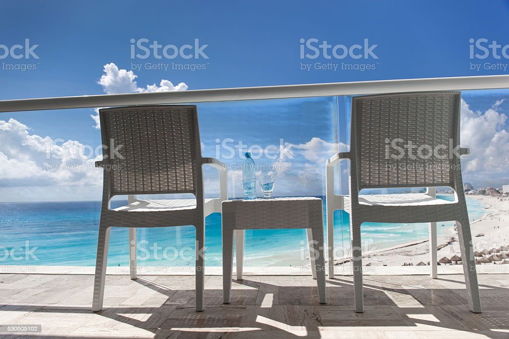 Balcony with wicker chairs and table stock photo