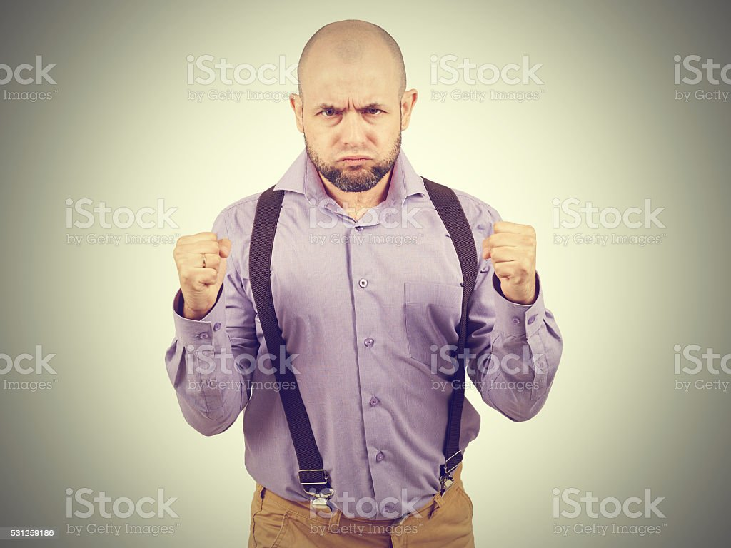 Bald bearded man puffed out his cheeks stock photo