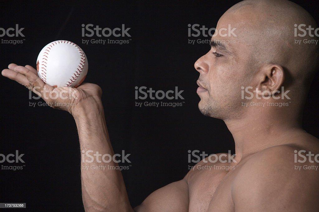 Bald body builder and baseball stock photo