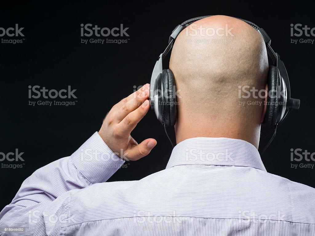 Bald headed man with headphone stock photo
