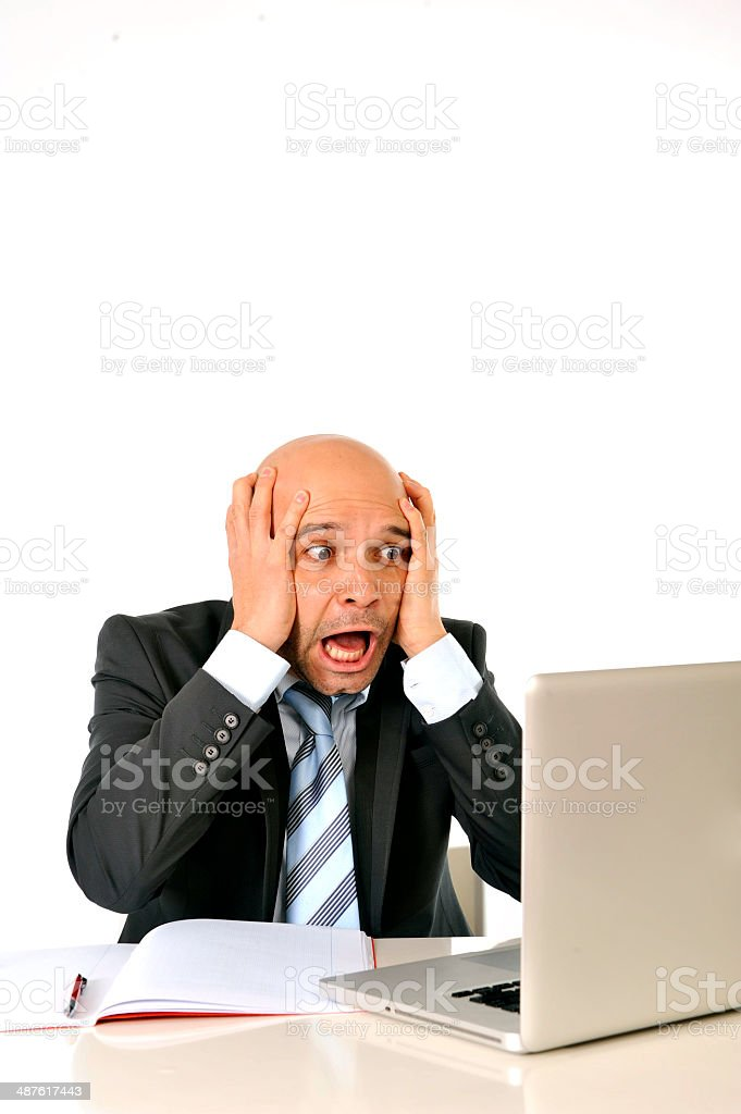 bald latin business man in stress screaming at computer royalty-free stock photo
