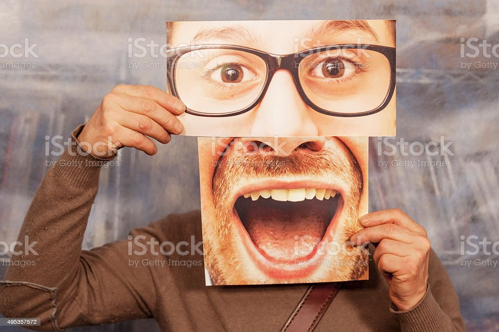 bald man holding a card with a big glasses stock photo