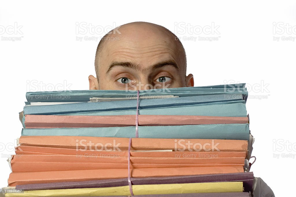 Bald Man Looking Over Stack stock photo