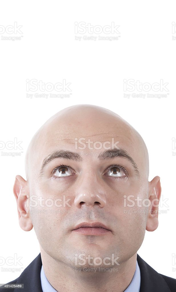 bald man looking up royalty-free stock photo