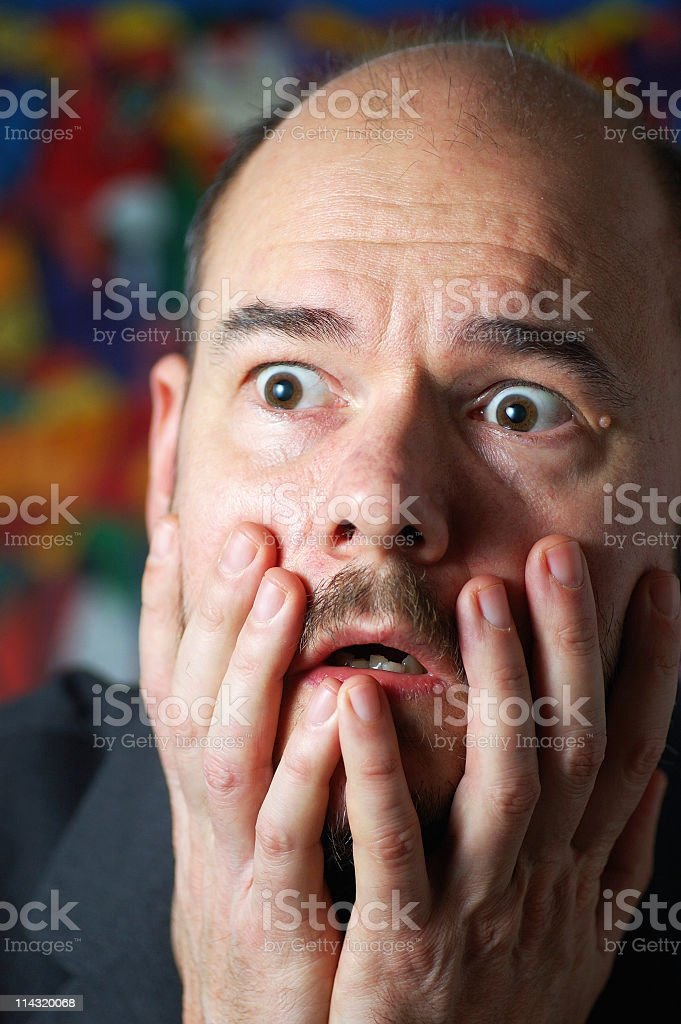 Bald Man Shocked and Fearful of His Baldness royalty-free stock photo