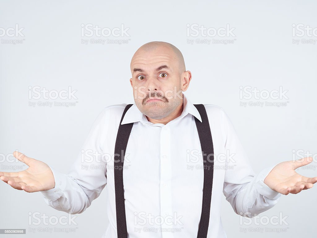 bald man shrugging shoulders I don't know gesture stock photo