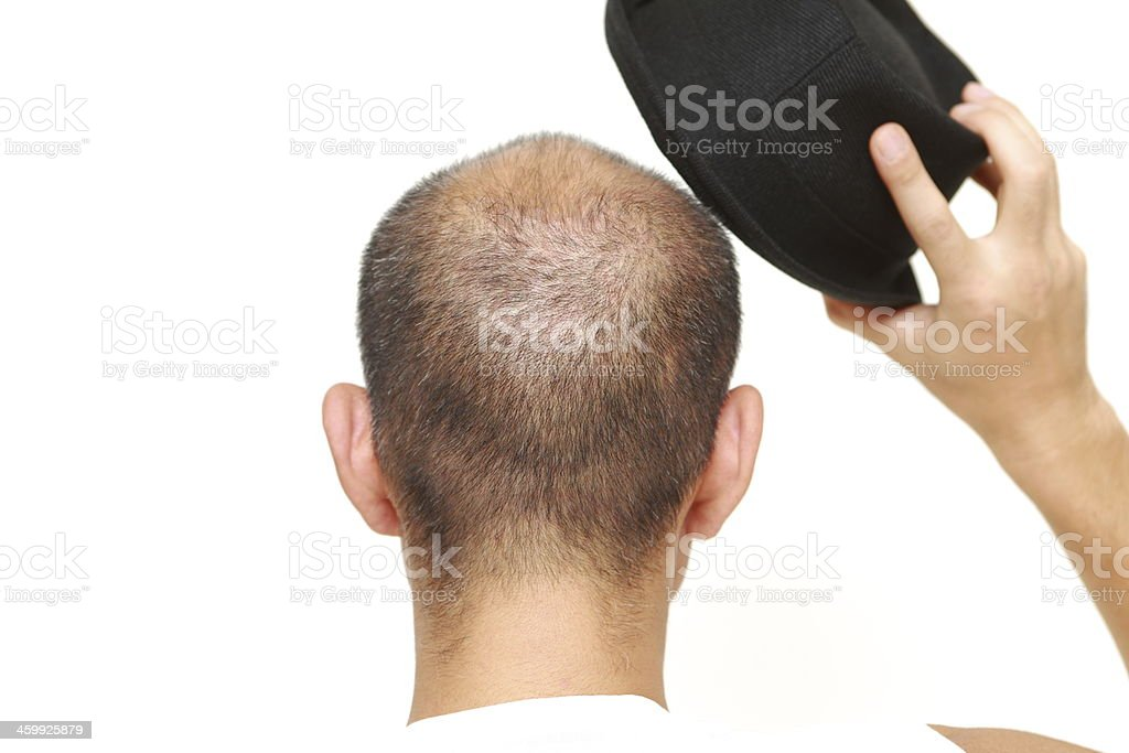 bald man with a hat stock photo