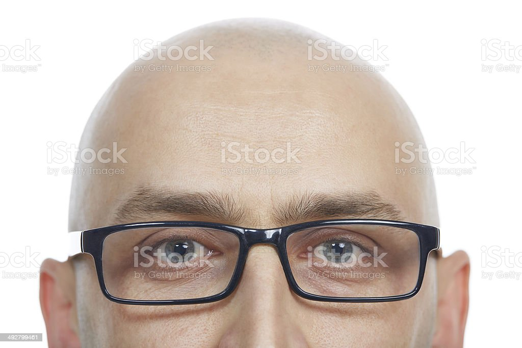 Bald man with eyeglasses looking stock photo