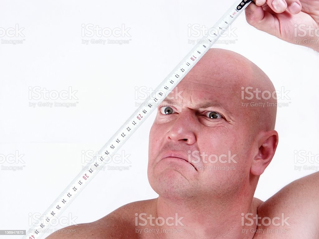 bald man with tape-measure royalty-free stock photo