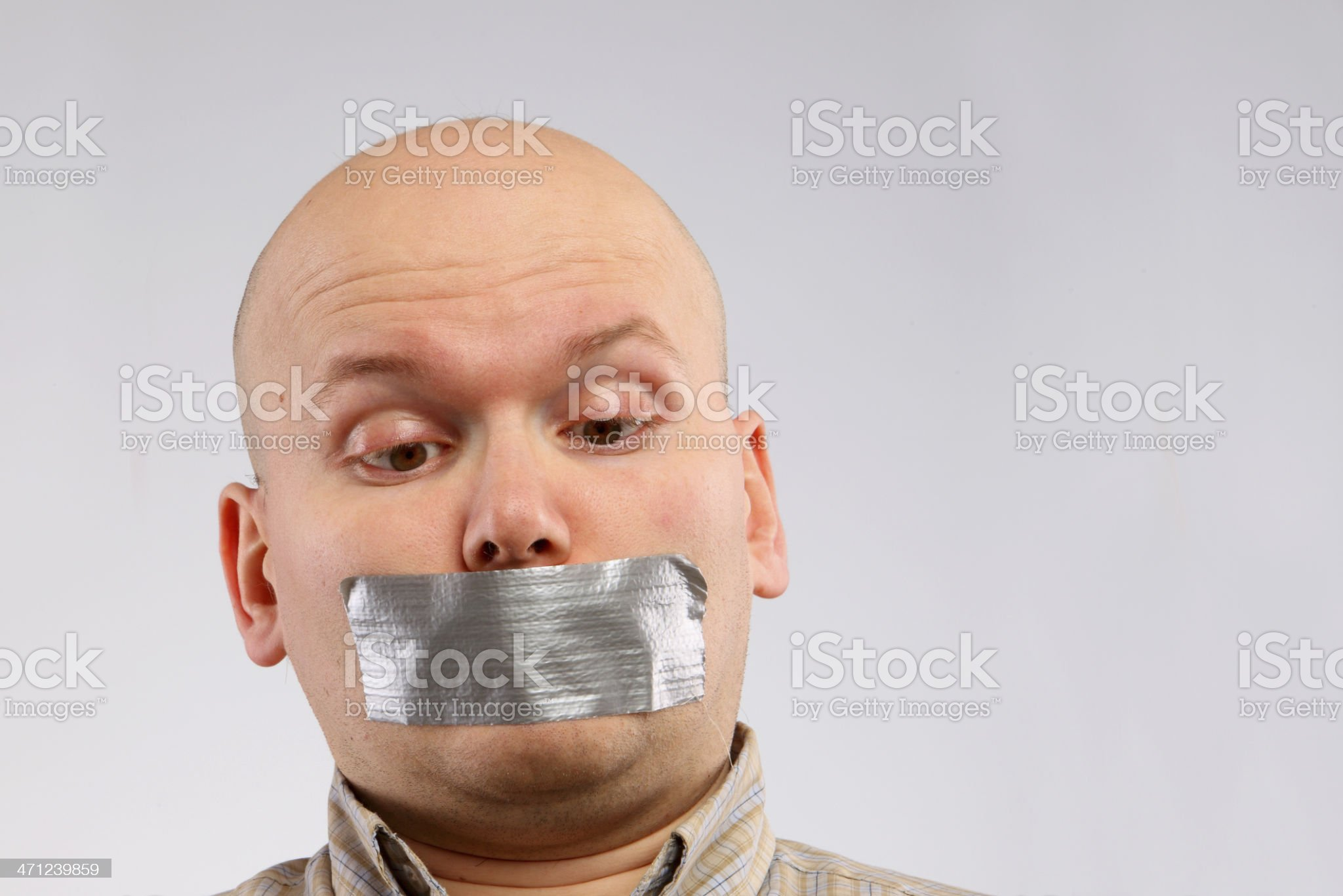 Bald man with the grey tape taped up on mouth royalty-free stock photo