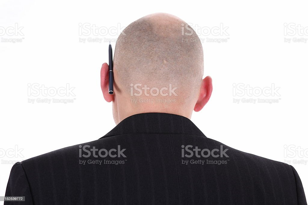 bald man's head with pen royalty-free stock photo
