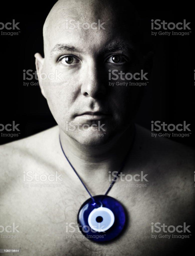 bald monk with evil eye amulet royalty-free stock photo