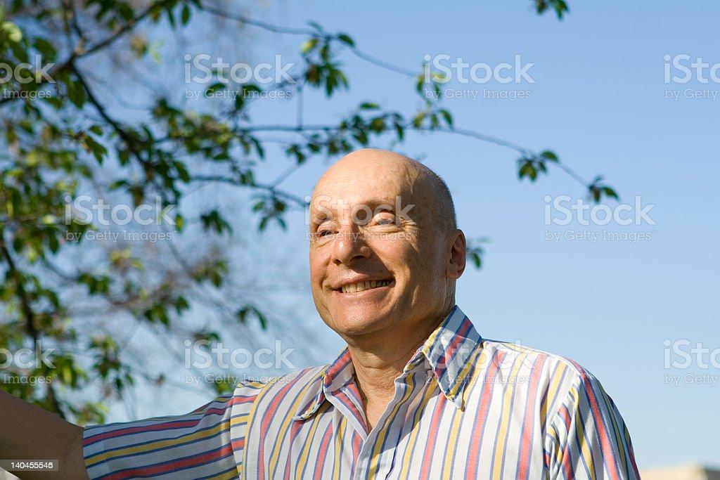 Bald Senior Man Smiling Outside Striped Shirt royalty-free stock photo