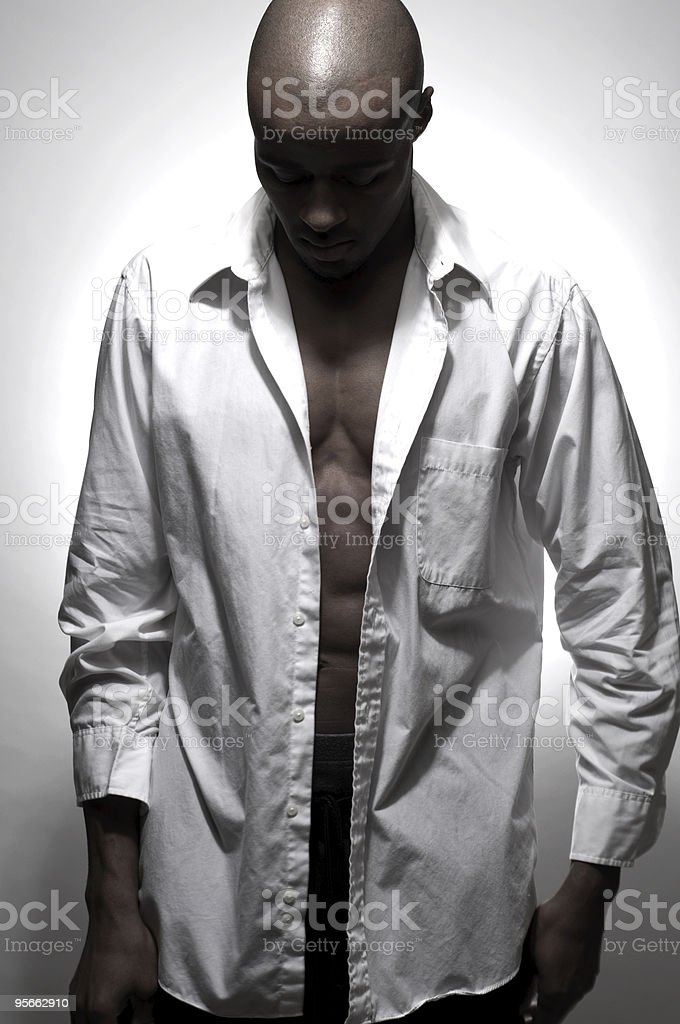 Bald Young Black Male Looking Downward As If Depressed royalty-free stock photo
