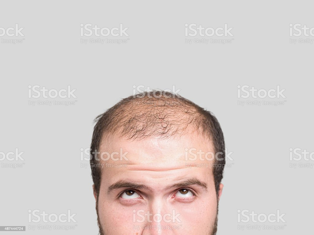 Bald young man, front view stock photo