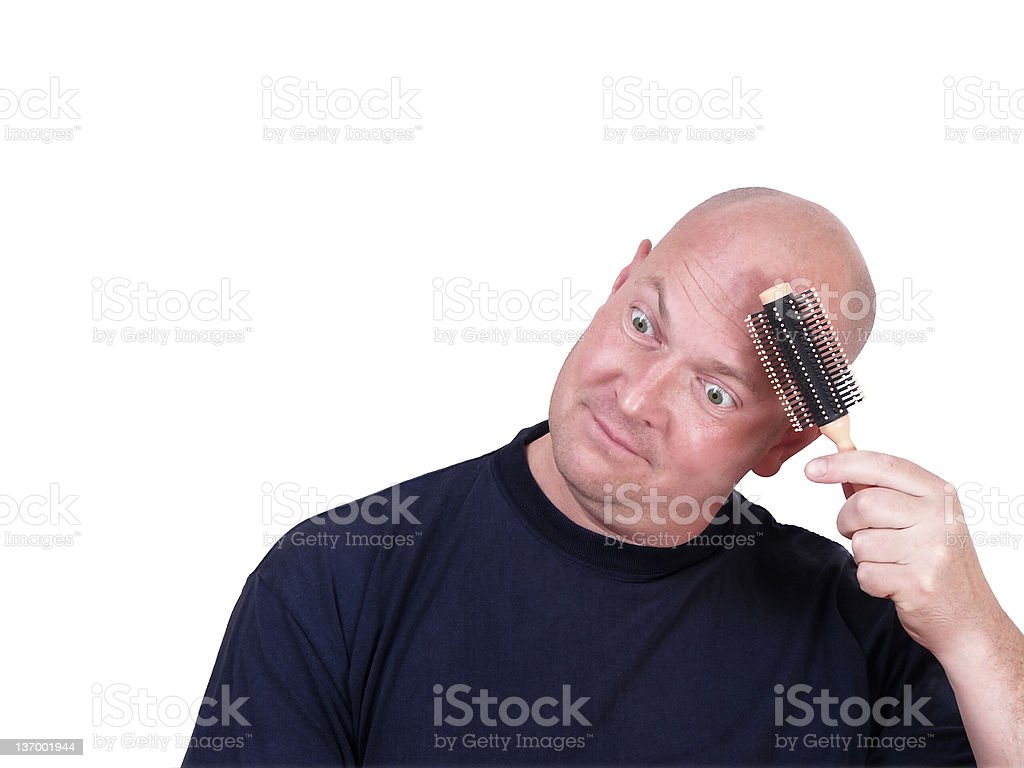 bald-headed man trying to use hairbrush royalty-free stock photo