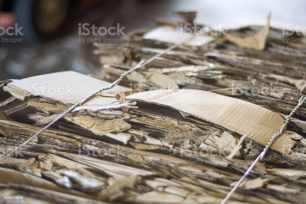 bale of cardboard wired up and ready to recycle stock photo