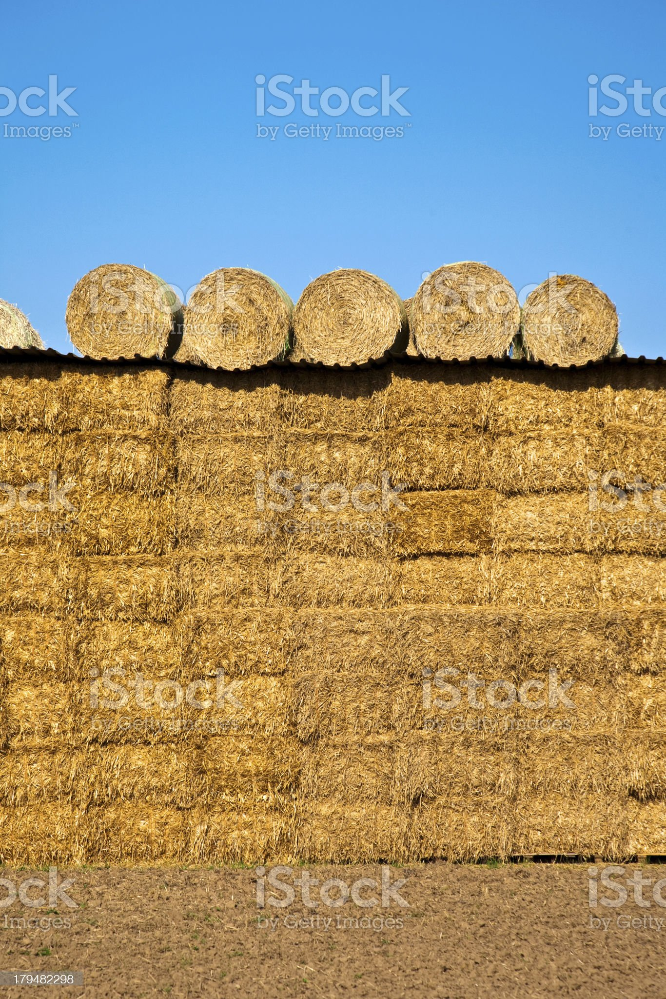bale of straw with blue sky royalty-free stock photo