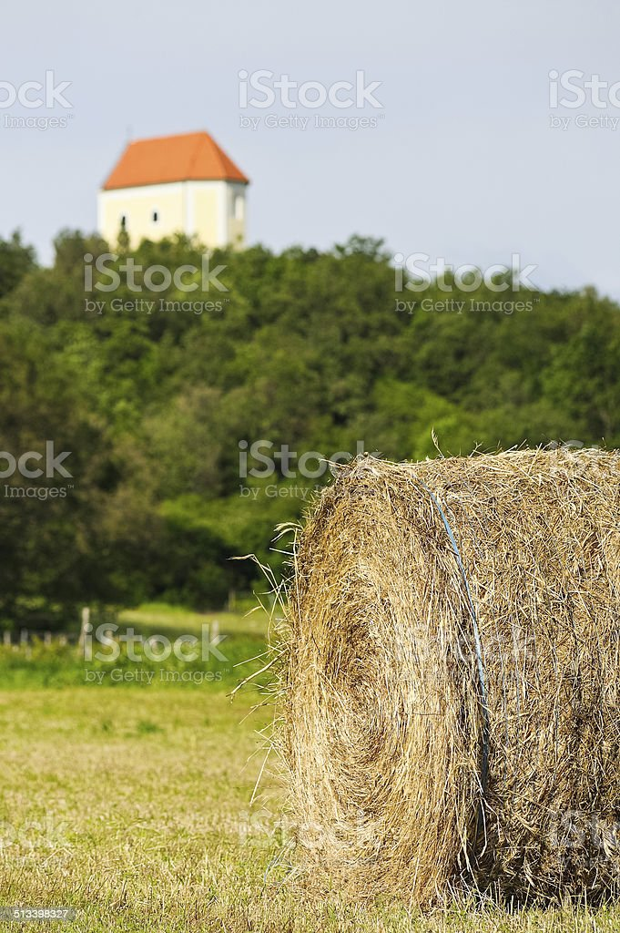 Bale of straw with chapel of St. Margaret stock photo