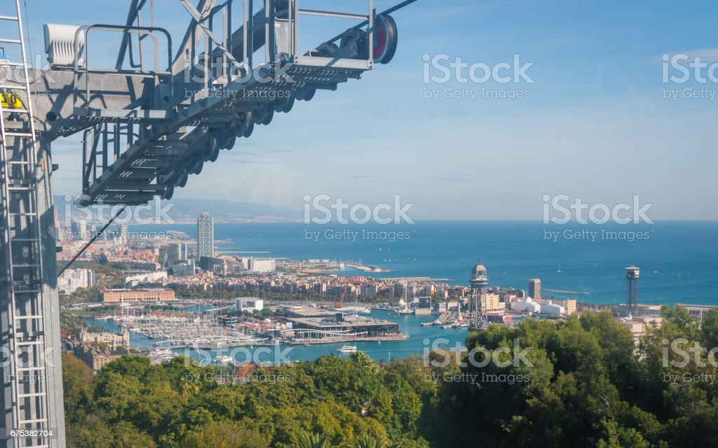 Balearic sea & coastline of modern cosmopolitan city seen from high, cable car over the city. stock photo