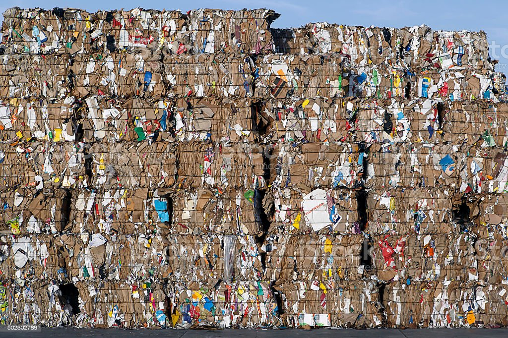 baled wastepaper for recyling stock photo