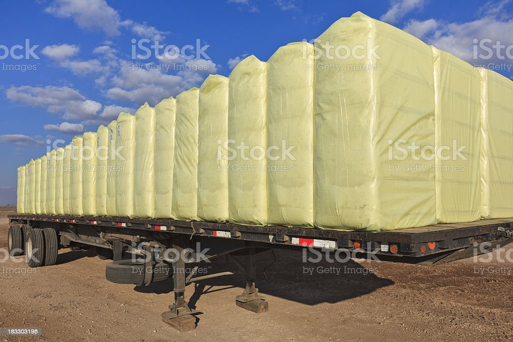 bales of cotton on flatbed truck trailer stock photo