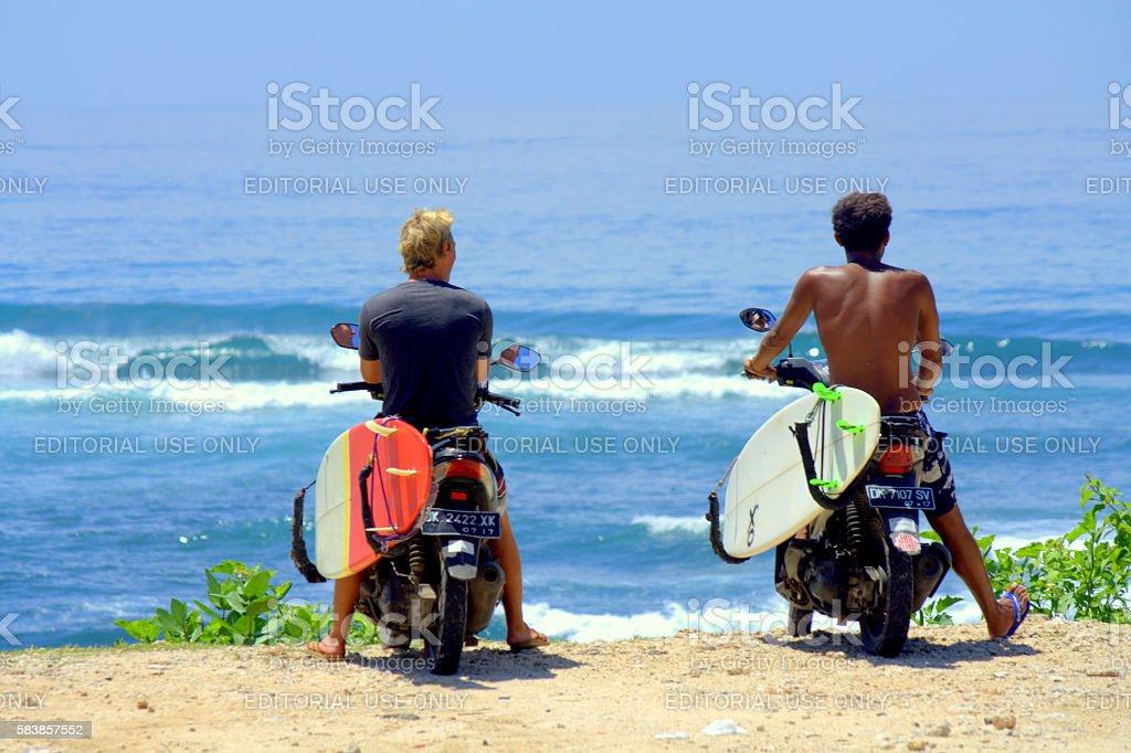 Bali surfers stock photo