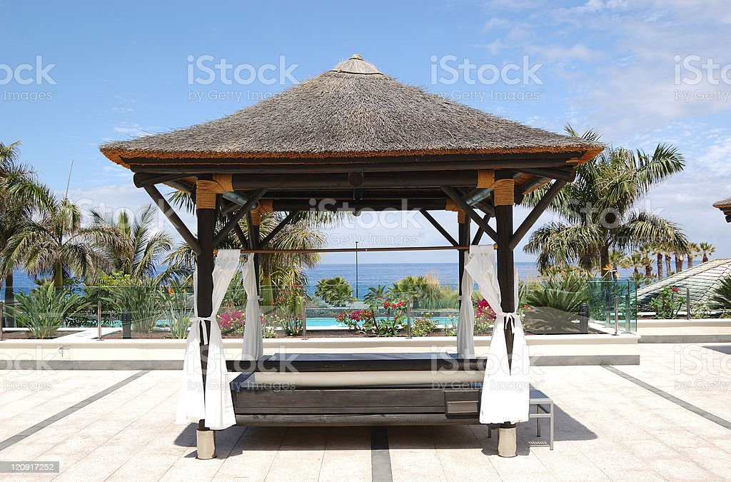 Bali type hut near beach and swimming pool royalty-free stock photo