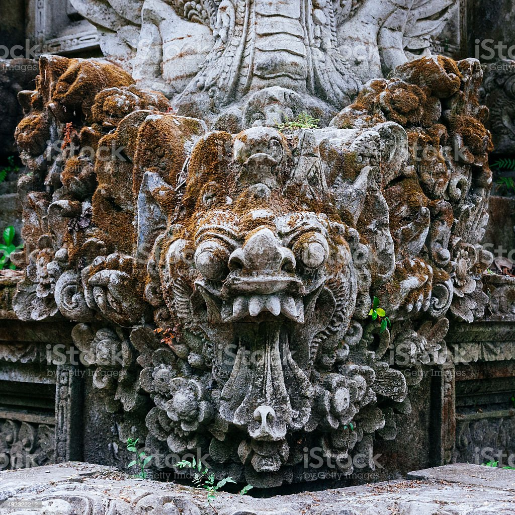 Balinese Barong stone-carving at Pura Gunung Lebah temple in Ubud stock photo