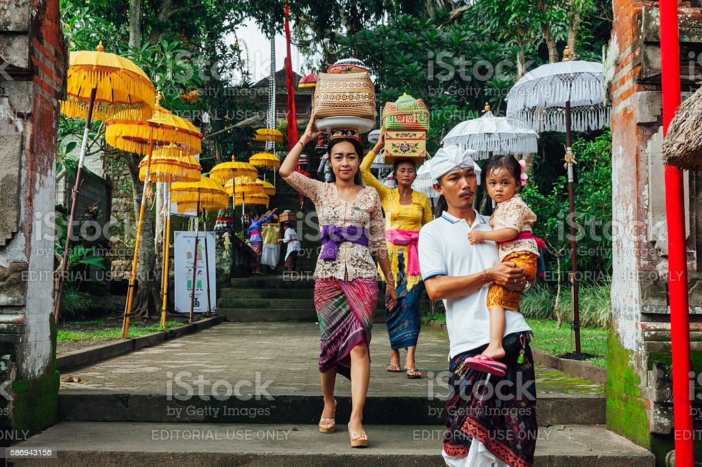 Balinese family in traditional clothes stock photo