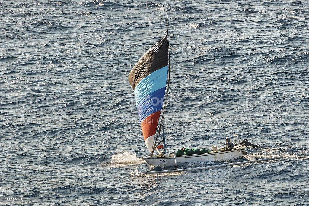 Balinese Fishing Boat Runs Before the Wind stock photo