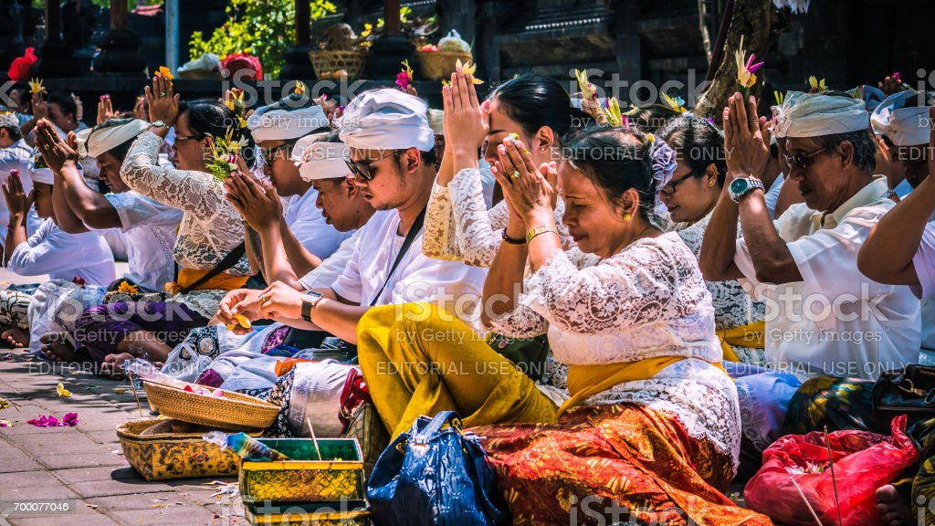 Balinese praying on ceremony at Pura Goa Lawah temple, Bali, Indonesia stock photo
