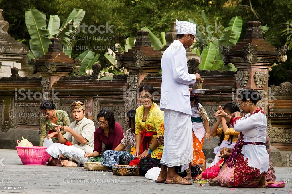 Balinese Priest & Devotees stock photo