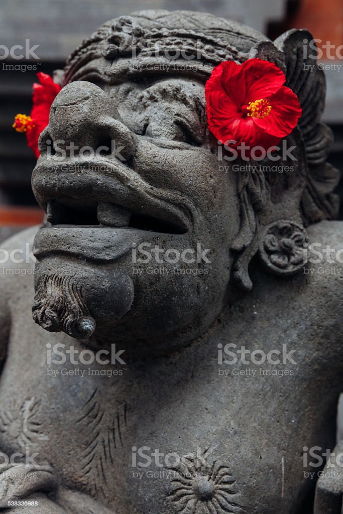 Balinese statue in the temple, Ubud, Bali stock photo